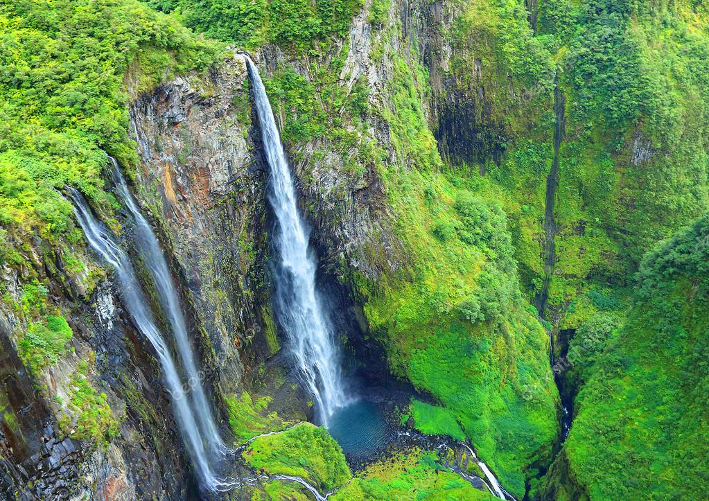 Aerial view to waterfall in rainforest.