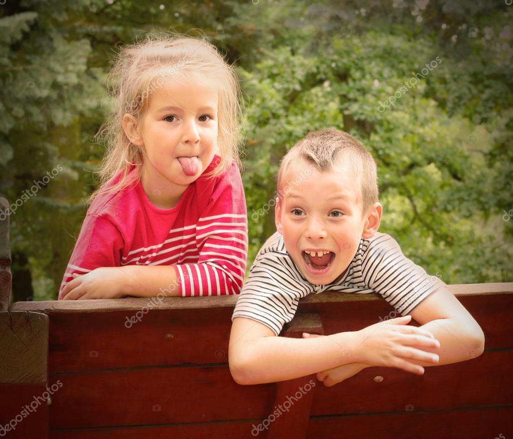 Funny kids enjoying holidays on countryside