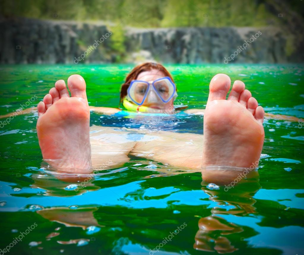 Happy traveler relaxing and enjoying holidays on lake
