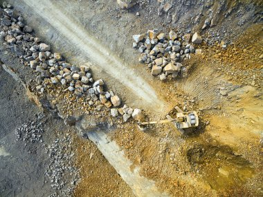Aerial view of a excavator in the mine.