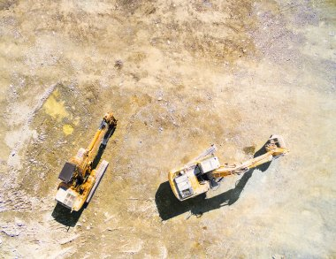 Aerial view of a excavator in the open cast mine.