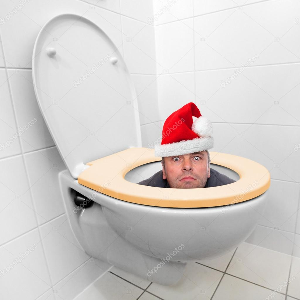 Santa Claus Looking From The Toilet Bowl Stock Photo