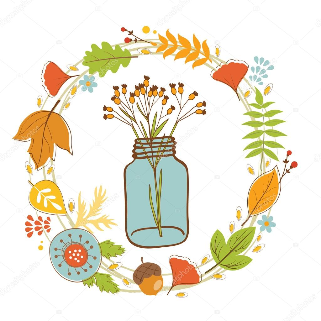 Wild flowers in a glass jar with floral wreath