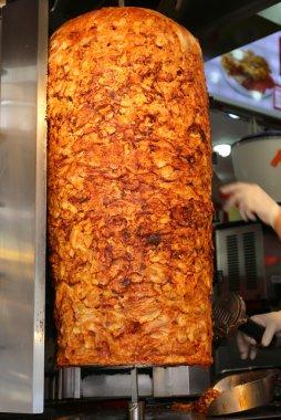 Chef slicing Chicken Doner Kebab at local restaurant in Beyoglu