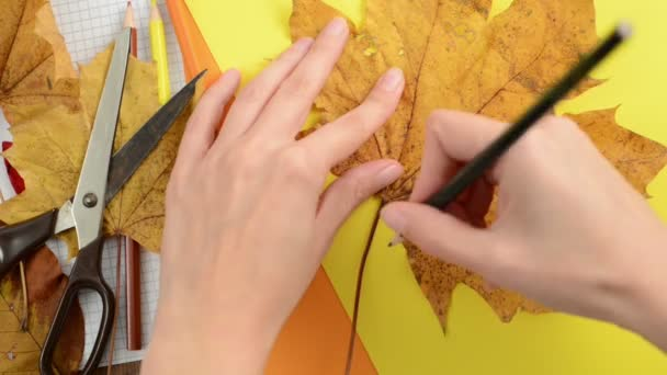 Painting maple leaves on cardboard box paper
