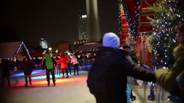 People ice skating on xmas fair at berlin alexanderplatz