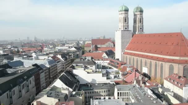 Frauenkirche at historical city of Munich. Cityscape overview from top of town hall.