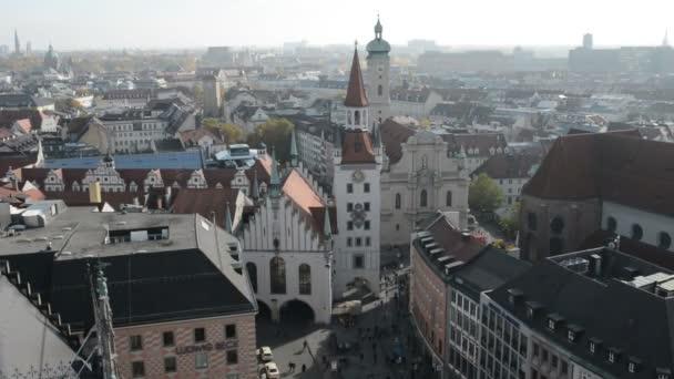 view from top of Town hall at Marienplatz to Viktualienmarkt. People walking around.