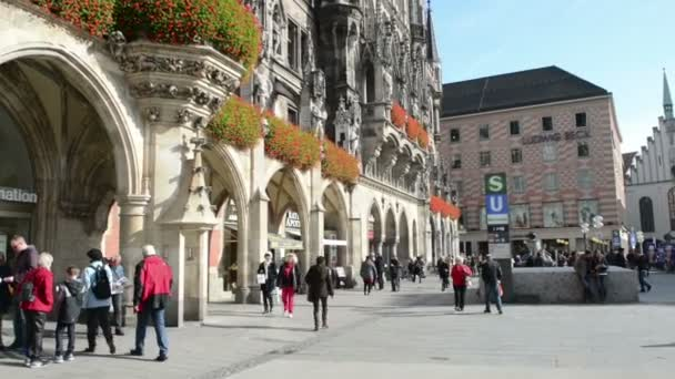 Cityscape of Munich. People walking over the Marienplatz.