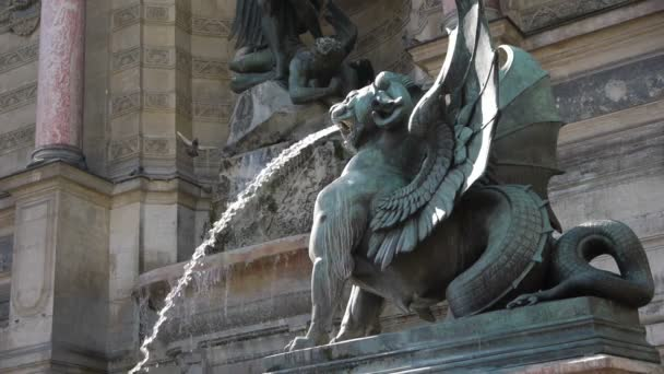 fountain and sculpture of saint Michel and dragon