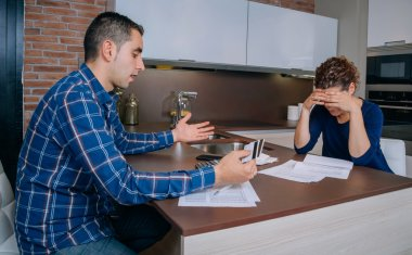 Desperate couple reviewing their credit card debts