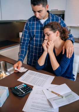 Unemployed husband gives solace to his wife crying by debts