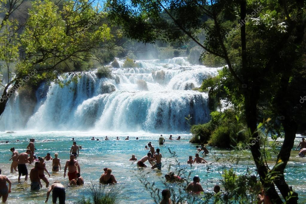 Tourists swimming in Krka National Park waterfalls, Croatia