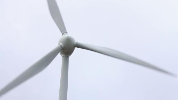 Alternative energy wind turbine rotating. Energy consumption and green renewable energy industry