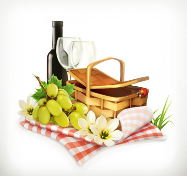 tablecloth and picnic basket, wine glasses and grapes