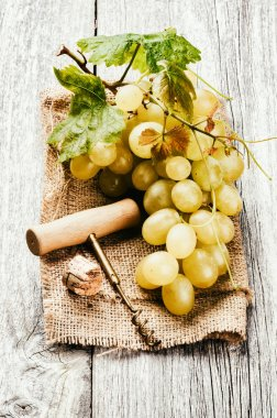 Bunch of grape in rustic setting