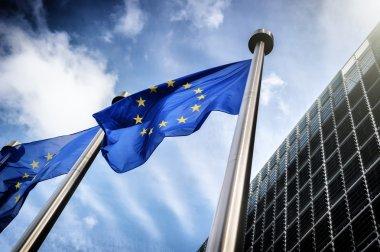 European Union flags on blue sky background stock vector