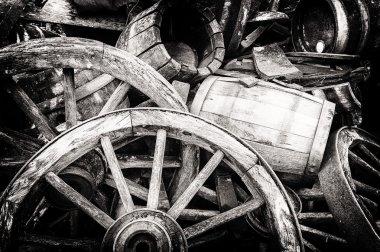 Old wooden barrels and broken wheels