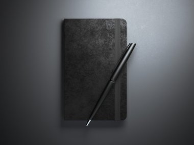 Black copybook with pen