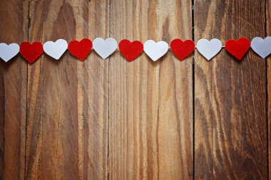 Red and White Ppaper hearts on the clothesline On  wood backgrou