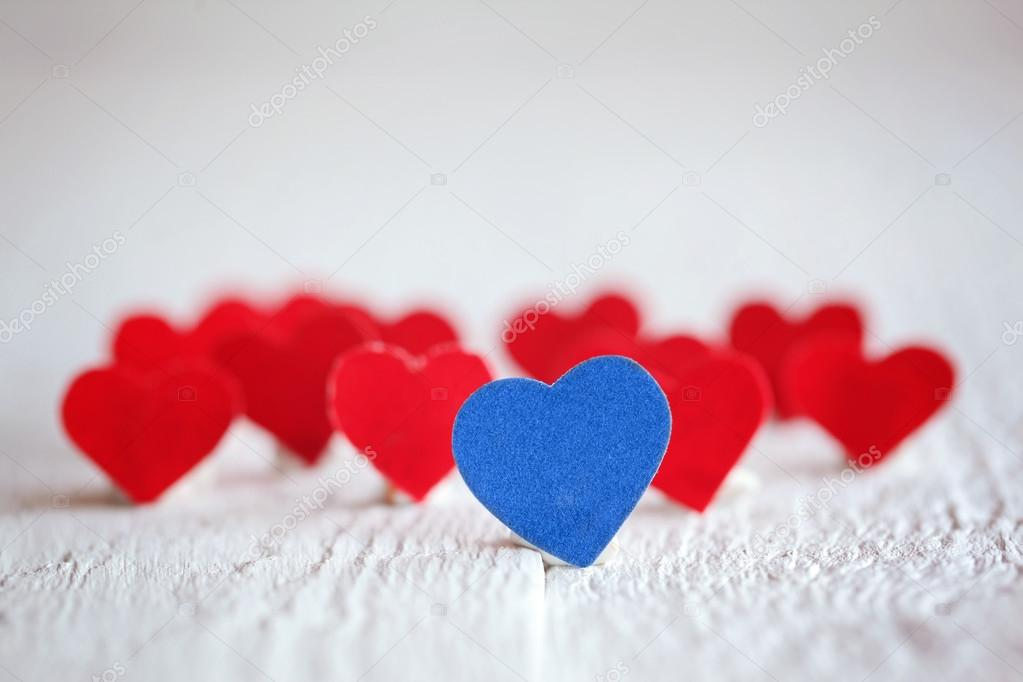 Blue Heart And Many Red Hearts On The White Background Valentin