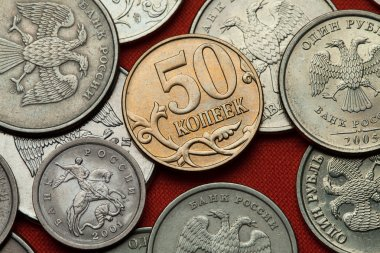 Coins of Russia on red table