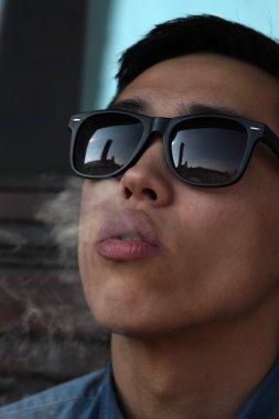 Asian man smoking