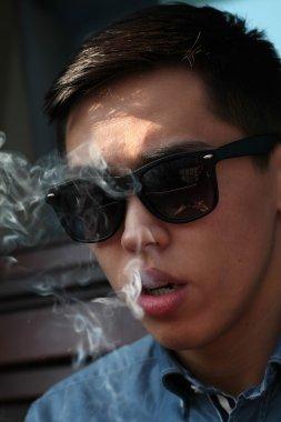 Asian man in sunglasses