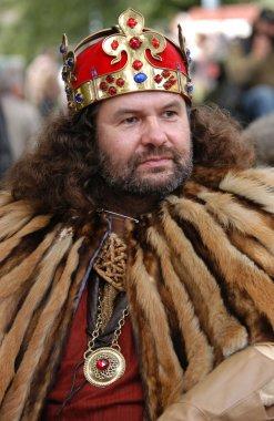 Bearded man dressed as King
