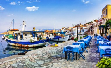 Traditional Greece series - Chalki island with old boats and taverna