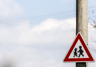 road sign with warning - protection of children near school
