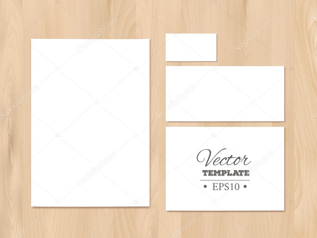 blank corporate identity templates on a wooden background stationery templates paper sheet business card letterhead