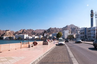 Tourist walking on Corniche, Muscat, Oman