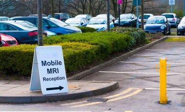 Mobile MRI scanning sign in a car park