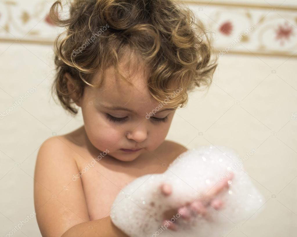 Little girl in the bathtub — Stock Photo © MarcoGovel #60273533