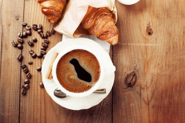Fresh croissants and cup of coffee