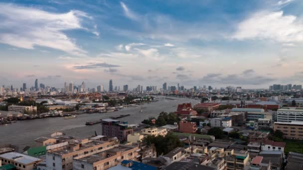 Timelapse day to night of Bangkok city skyline and Chao Phraya river