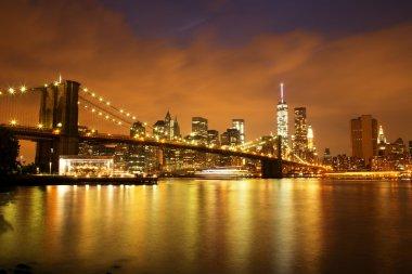 New York City Manhattan Downtown with Brooklyn Bridge at dusk