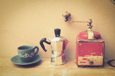 italian coffee maker and flower