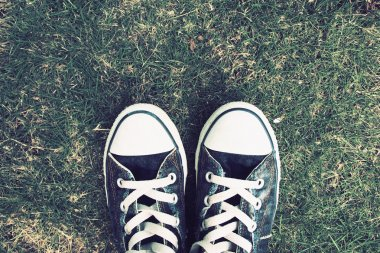 Retro Photo Of Vintage Sneakers On Grass