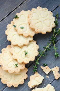 Homemade gluten free shortbread cookies with branches of thyme
