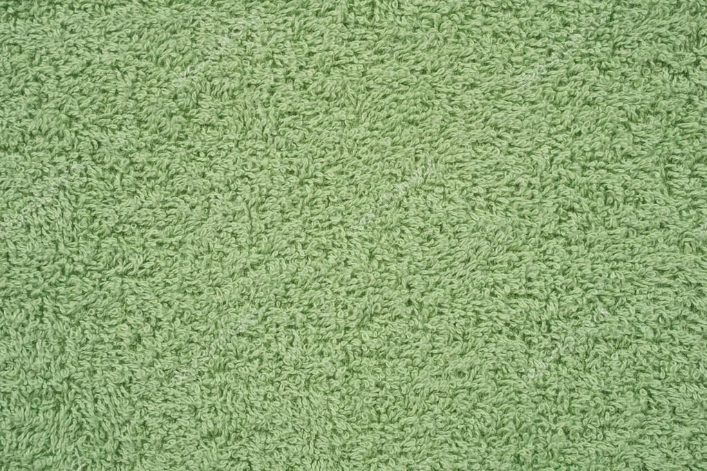 A varratmentes háttérben zöld frottír törölköző — Fotó szerzőtől photopotam 8e8d84ae97