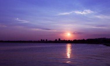 Sea sunset city
