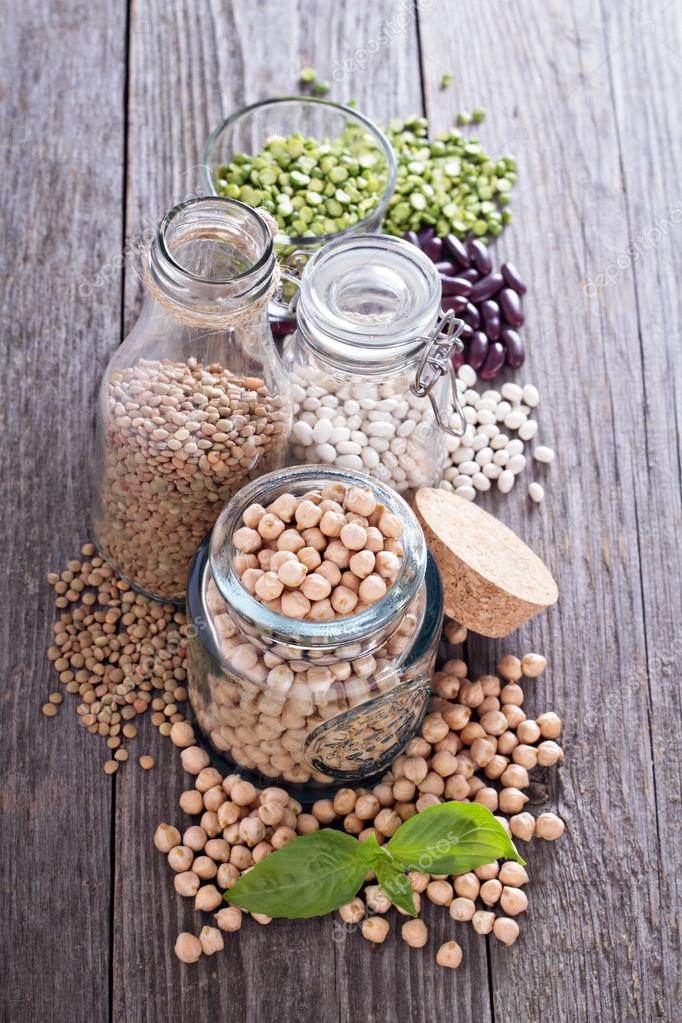 Raw beans and lentils in jars