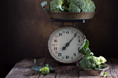 Fresh broccoli on old kitchen scales