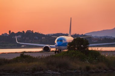 Airplane before take-off, evening scene, Corfu