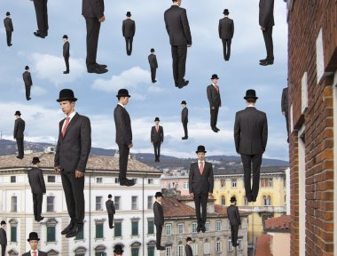 Businessmen floating in the sky