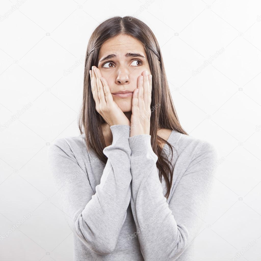 young beautiful woman worried face expression � stock