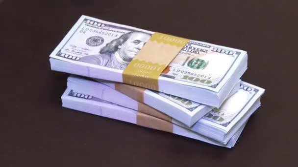 A pile of 40,000 dollars in new 100 dollar bills gets slid across the desk.