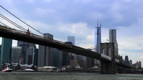 A dramatic time lapse of the New York City skyline behind the Brooklyn Bridge.